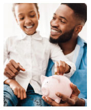 photo man holding his son and a piggy bank